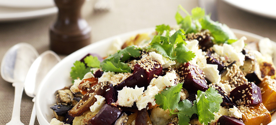 Baked vegetables with dates and feta