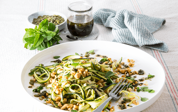 Zucchini and almond salad with balsamic and oregano dressing